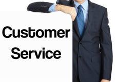 το άτομο στηρίζεται στο έμβλημα με τον πελάτη S επιγραφής Στοκ εικόνες με δικαίωμα ελεύθερης χρήσης