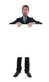 Το άτομο στο επιχειρησιακό κοστούμι παρουσιάζει στον πίνακα διαφημίσεων Στοκ φωτογραφίες με δικαίωμα ελεύθερης χρήσης