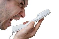 Το άτομο φωνάζει στο τηλέφωνο η ανασκόπηση απομόνωσε το λευκό Στοκ Φωτογραφία