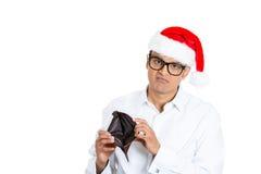 Το άτομο Χριστουγέννων με τα μεγάλα μαύρα γυαλιά έσπασε οικονομικά Στοκ εικόνες με δικαίωμα ελεύθερης χρήσης