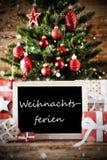 Το δέντρο με Weihnachtsferien σημαίνει τις διακοπές Χριστουγέννων Στοκ Φωτογραφίες