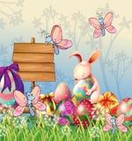 Το λαγουδάκι και οι πεταλούδες στον κήπο με τα αυγά Πάσχας ελεύθερη απεικόνιση δικαιώματος