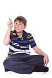 Το αγόρι εμφανίζει δάχτυλό του Στοκ Φωτογραφία