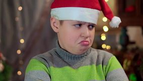 Το αγόρι στο πουλόβερ και το καπέλο Άγιου Βασίλη είναι και Δεν έχει κανένα δώρο Κινηματογράφηση σε πρώτο πλάνο, ενάντια φιλμ μικρού μήκους