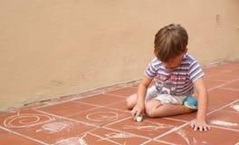 το αγόρι σύρει Στοκ Φωτογραφία