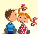 Το αγόρι φιλά το κορίτσι στο μάγουλο Στοκ Εικόνες