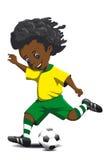 Το αγόρι χτυπά μια σφαίρα ποδοσφαίρου Στοκ Εικόνα