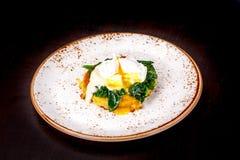 Το λαθραίο σπανάκι αυγών Στοκ εικόνα με δικαίωμα ελεύθερης χρήσης
