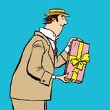 Το αναδρομικό άτομο δίνει ένα δώρο Στοκ φωτογραφία με δικαίωμα ελεύθερης χρήσης