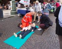 Το αντιπροσωπευτικό ασθενοφόρο διευθύνει τις κατηγορίες σε υπαίθριο πρώτα στο α Στοκ φωτογραφία με δικαίωμα ελεύθερης χρήσης