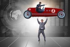 Το ανυψωτικό αθλητικό αυτοκίνητο επιχειρηματιών στην έννοια δύναμης Στοκ Φωτογραφία