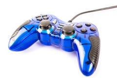 Το απομονωμένο μπλε πηδάλιο για το τηλεοπτικό παιχνίδι ελεγκτών και παιχνιδιού απομονώνει στοκ εικόνες