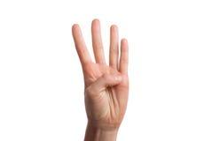 Το απομονωμένο χέρι παρουσιάζει τον αριθμό τέσσερα Στοκ Φωτογραφία