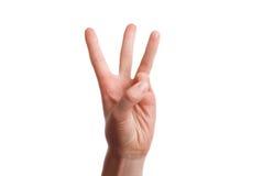 Το απομονωμένο χέρι παρουσιάζει τον αριθμό τρία Στοκ Εικόνες