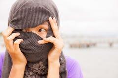 Το ασιατικό πρόσωπο είναι coverd Στοκ φωτογραφία με δικαίωμα ελεύθερης χρήσης