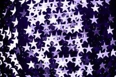 Το αστέρι διαμόρφωσε το θολωμένο bokeh υπόβαθρο με τα σπινθηρίσματα Υπεριώδης ακτίνα στοκ εικόνα