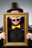 Το αστείο άτομο με το πλαίσιο εικόνων στοκ εικόνα με δικαίωμα ελεύθερης χρήσης