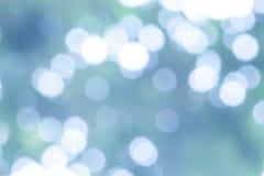 Το αφηρημένο ανοικτό μπλε bokeh περιβάλλει το υπόβαθρο Στοκ Εικόνες