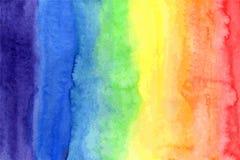 Το αφηρημένο ουράνιο τόξο watercolor χρωματίζει το υπόβαθρο Στοκ Εικόνες