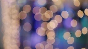 Το αφηρημένο φως Bokeh, γιορτάζει τη λάμπα φωτός διακοσμήσεων bokeh, το φως Χριστουγέννων ακτινοβολεί πυράκτωση, θαμπάδα Bokeh κα απόθεμα βίντεο