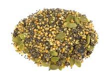 Το βακκίνιο Chia και δημητριακά προγευμάτων σπόρων κολοκύθας στο άσπρο backg Στοκ Εικόνες