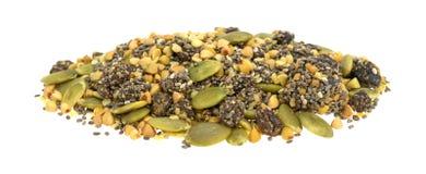 Το βακκίνιο Chia και δημητριακά προγευμάτων σπόρων κολοκύθας στο άσπρο backg Στοκ φωτογραφία με δικαίωμα ελεύθερης χρήσης