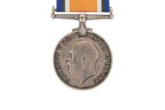 Το βρετανικό πολεμικό μετάλλιο, 1914-18 με την κορδέλλα, ασημένιο εκλεκτής ποιότητας στρατιωτικό μετάλλιο (τρίξιμο), obverse, παγ Στοκ φωτογραφία με δικαίωμα ελεύθερης χρήσης