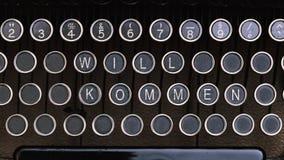 Το γερμανικό Word Willkommen στα εκλεκτής ποιότητας κλειδιά επιστολών συγγραφέων τύπων Στοκ Εικόνες
