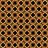 Το γεωμετρικό σχέδιο των πορτοκαλιών και μαύρων τετραγώνων και rhombuses Στοκ Φωτογραφία