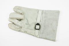 Το γκρίζο γάντι για προστατεύει τη ηλεκτροπληξία στοκ φωτογραφίες με δικαίωμα ελεύθερης χρήσης