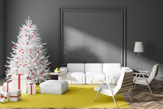 Το γκρίζο καθιστικό με το χριστουγεννιάτικο δέντρο και παρουσιάζει ελεύθερη απεικόνιση δικαιώματος