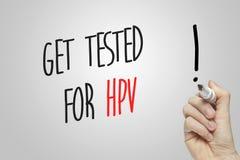 Το γράψιμο χεριών παίρνει δοκιμασμένο για HPV Στοκ Φωτογραφία