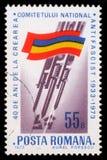 Το γραμματόσημο που τυπώνεται από τη Ρουμανία, παρουσιάζει ρουμανική σημαία, ξιφολόγχες που διαπερνούν τον αγκυλωτό σταυρό Στοκ Εικόνες