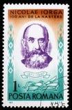 Το γραμματόσημο που τυπώνεται στη Ρουμανία παρουσιάζει Nicolae Iorga στοκ φωτογραφία