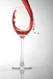 το γυαλί χύνει το κόκκινο Στοκ φωτογραφία με δικαίωμα ελεύθερης χρήσης