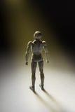 Το ειδώλιο ατόμων που στέκεται σε ισχυρό θέτει να ανατρέξει με την ακτίνα του λ Στοκ φωτογραφία με δικαίωμα ελεύθερης χρήσης