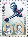 Το εκλεκτής ποιότητας γραμματόσημο που τυπώνεται στην Πολωνία παρουσιάζει Φ Zwirko και S Wigura και η πρόκληση Zwyciezcy, 1932 στοκ εικόνες