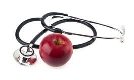 το εννοιολογικό σιτηρέσιο μήλων που τρώει την υγειονομική περίθαλψη υγιή επεξηγεί το στηθοσκόπιο διατροφής εικόνας Στοκ φωτογραφία με δικαίωμα ελεύθερης χρήσης