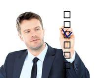 Το επιχειρησιακό άτομο επισύρει την προσοχή με το δείκτη στο κενό διάστημα αντιγράφων που απομονώνεται στο wh Στοκ φωτογραφία με δικαίωμα ελεύθερης χρήσης