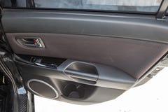 Το εσωτερικό του αυτοκινήτου Mazda 3 με μια άποψη του ταμπλό, των καθισμάτ στοκ εικόνες