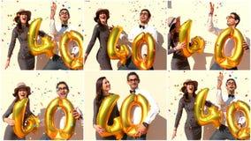 Το εύθυμο ζεύγος γιορτάζει γενέθλια σαράντα ετών με τα μεγάλα χρυσά μπαλόνια Στοκ φωτογραφία με δικαίωμα ελεύθερης χρήσης