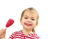 Το εύθυμο κορίτσι με το lollipop Στοκ Εικόνες