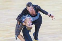 Το ζεύγος χορού της Ηλείας Shvaunov και της Anna Sneguir εκτελεί το λατινοαμερικάνικο πρόγραμμα νεολαία-2 Στοκ Εικόνα