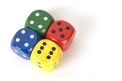Το ζωηρόχρωμο τυχερό παιχνίδι τέσσερα χωρίζει σε τετράγωνα σε ένα άσπρο υπόβαθρο υποβάθρου που βλέπει Στοκ Φωτογραφία