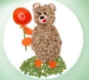 Το δημιουργικό φυτικό γεύμα τροφίμων αντέχει τη μορφή Στοκ εικόνες με δικαίωμα ελεύθερης χρήσης