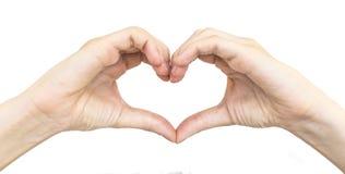 Το θηλυκό παραδίδει τη μορφή καρδιάς που απομονώνεται στοκ εικόνα με δικαίωμα ελεύθερης χρήσης