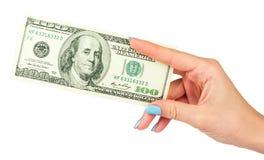 Το θηλυκό χέρι κρατά το δολάριο σε ένα απομονωμένο άσπρο υπόβαθρο Στοκ Εικόνες