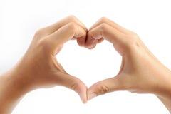 Το θηλυκό παραδίδει τη μορφή της καρδιάς Στοκ εικόνα με δικαίωμα ελεύθερης χρήσης