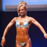 Το θηλυκό πρότυπο αριθμού παρουσιάζει καλύτερό της στο πρωτάθλημα στη σκηνή Στοκ Εικόνα