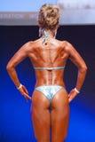 Το θηλυκό πρότυπο αριθμού παρουσιάζει καλύτερό της στο πρωτάθλημα στη σκηνή Στοκ Εικόνες